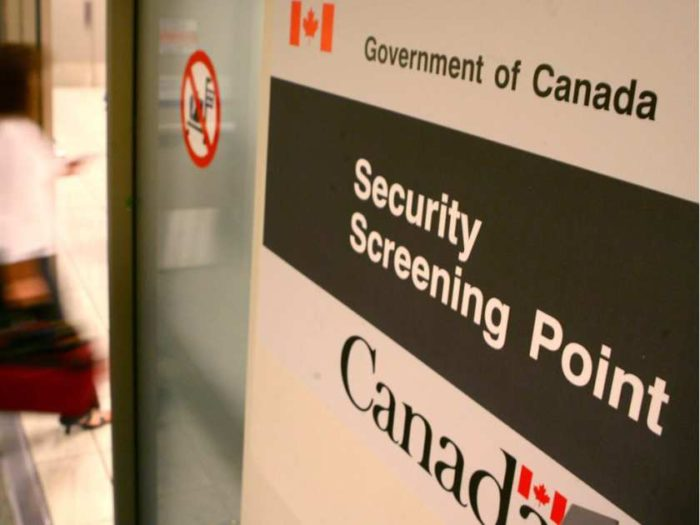 passengers-walk-into-one-of-th-security-screening-points-at